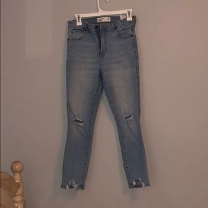 Light wash skinny Abercrombie jeans with rips
